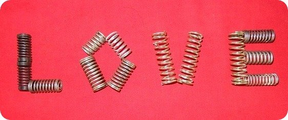"a series of metal springs making up the word ""love"""